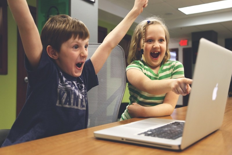 enthusiastic-children-playing-on-computer