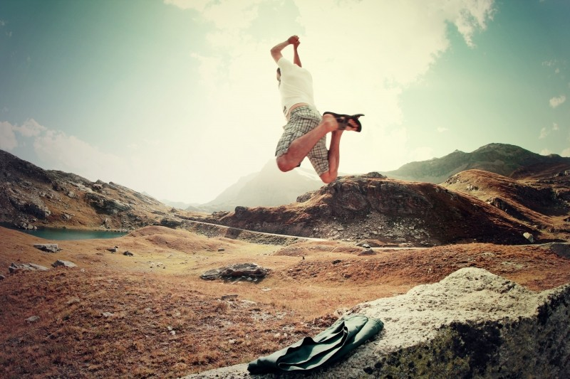 man-jumping-on-rock-in-mountains