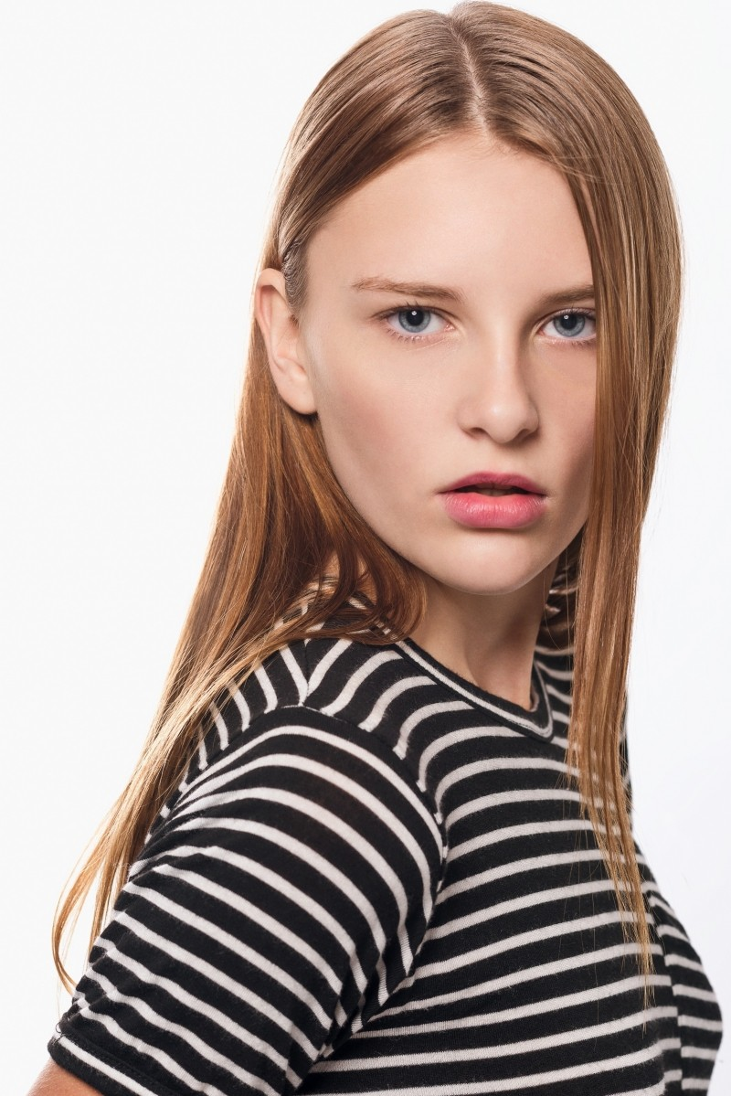 portrait-of-young-woman-wearing-striped-blouse