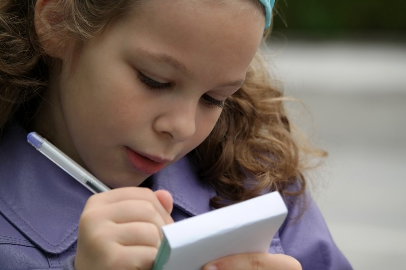 girl-writing-in-notebook